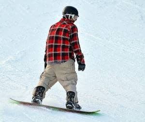 person on perisher snowboarding