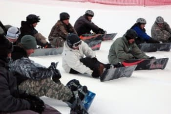 snowboarding lesson at snowy mountain accommodation